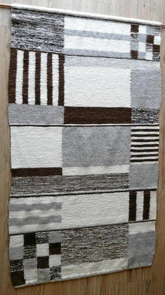 Der von Anna Schröder im Bauhaus-Stil gewebte Teppich schmückt einen Flur im Seniorenzentrum Andreashof, wo sie bis zu ihrem Tod im Oktober vorigen Jahres lebte.